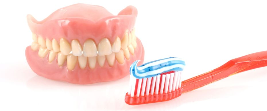 Dentures with toothbrush and toothpaste
